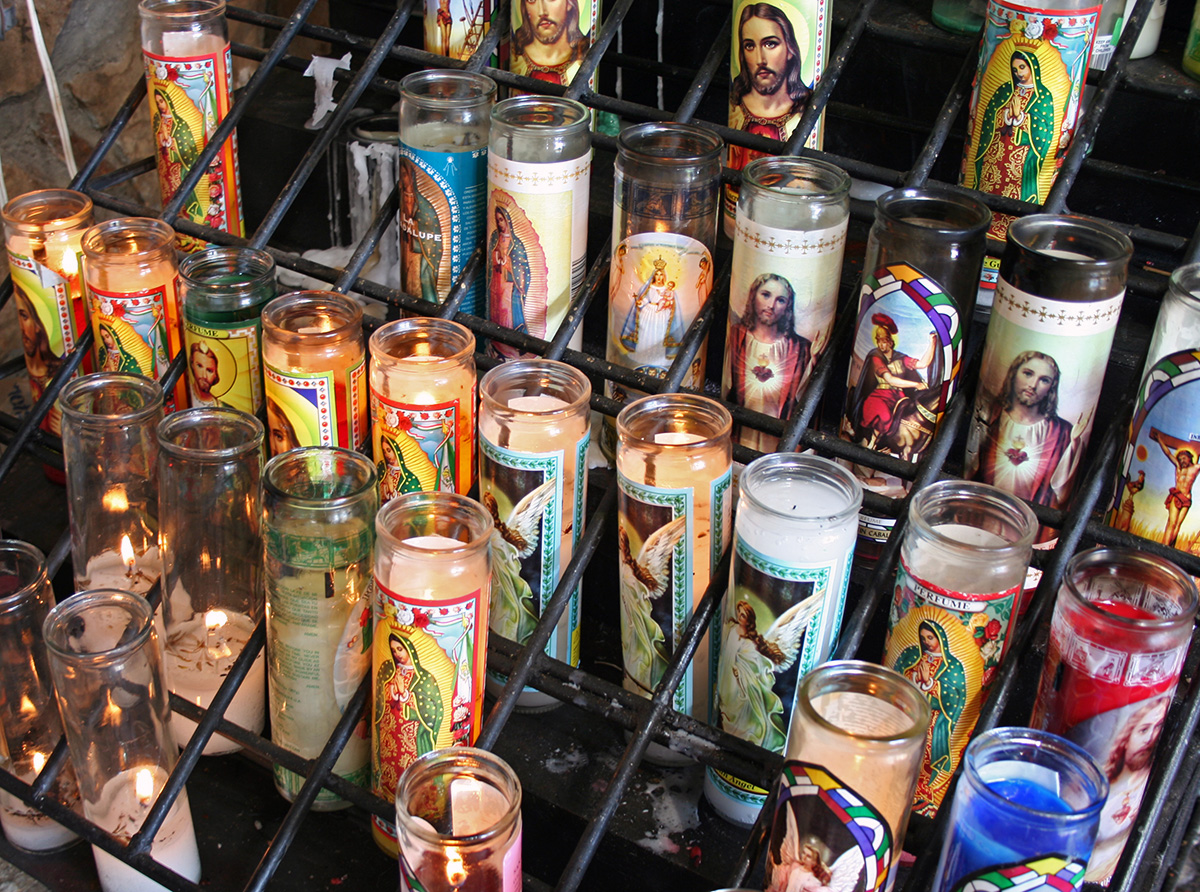 Votive_candles_at_a_roadside_grotto_in_north_Texas