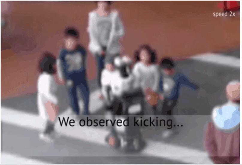 kids kicking robot